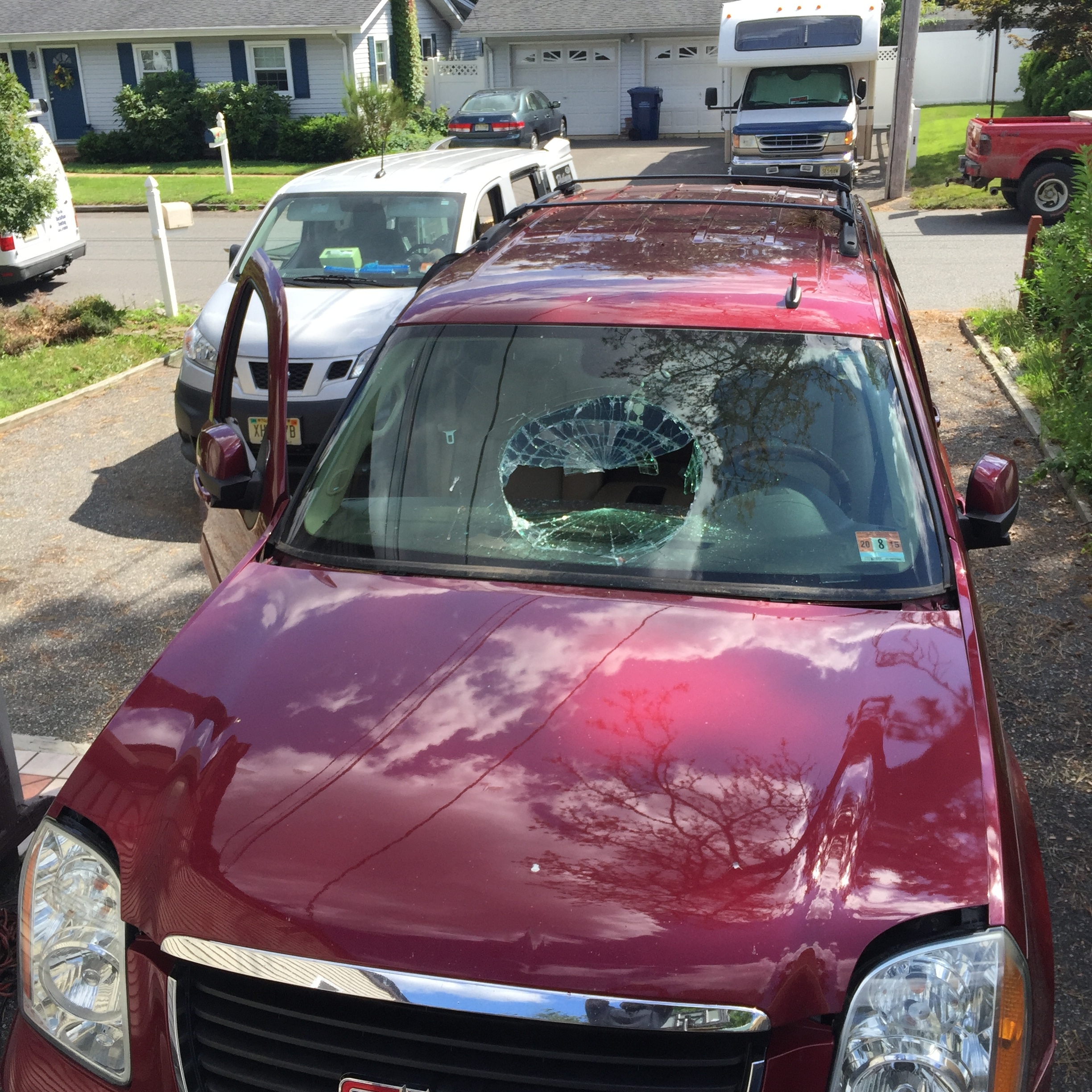 2012 GMC Yukon Smashed Windshield replacement cut out Platinum Auto Glass